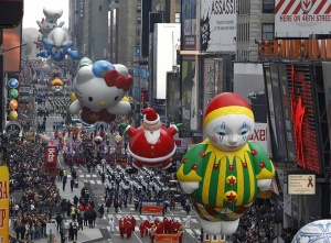 Balloons are paraded down 7th avenue during the 83rd Macy's Thanksgiving day parade in New York