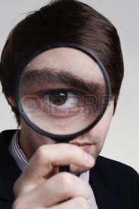 12506666-man-hold-up-a-magnifying-glass-to-his-eye-so-his-eye-looks-very-large
